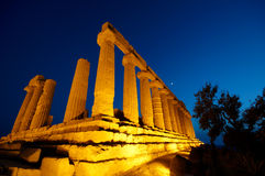Illuminated temple ruins. Low angle view of illuminated temple at night in Agrigento, Sicily, Italy Royalty Free Stock Images