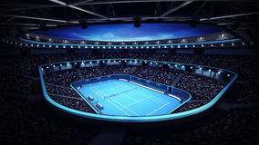 Illuminated tennis stadium with court and evening sky Stock Photo