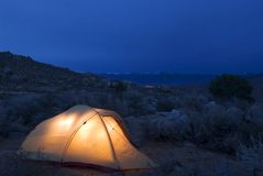 Illuminated tent. An illuminated tent at dusk while camping near Bishop, California Royalty Free Stock Photos