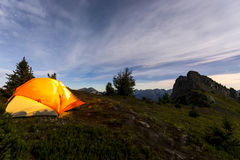 Illuminated tent camping on ridgeline of mountain. Illuminated tent camping on ridgeline of a mountain Stock Photography