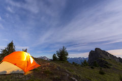 Illuminated tent camping on ridgeline of mountain. Illuminated tent camping on ridgeline of a mountain Royalty Free Stock Photography