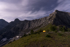 Illuminated tent camping on ridgeline of mountain. Illuminated tent camping on ridgeline of a mountain Stock Photos