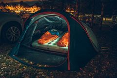 Illuminated Tent on Campsite. Inside Illuminated Tent on the Campsite at Night. Two Sleeping Bags Inside. Traveling with Tent Theme stock images