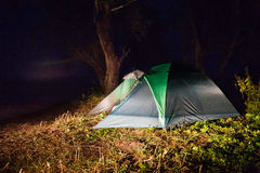 Illuminated tent at night in camping Royalty Free Stock Images