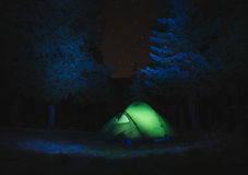 Illuminated Tent with stars and Mountains in the background Royalty Free Stock Image