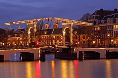 Illuminated Thiny bridge in Amsterdam Netherlands Stock Photos