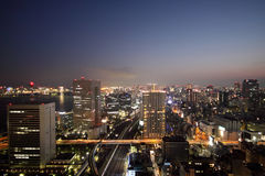 Illuminated Tokyo skyline during sunset Stock Photography