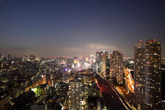 Illuminated Tokyo skyline during sunset Stock Images