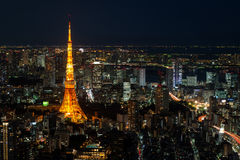 Illuminated Tokyo Tower and skyline at night from Roppongi Hills. Cityscape of Tokyo at night, as seen from the top of one of the highest buildings in Roppongi royalty free stock image