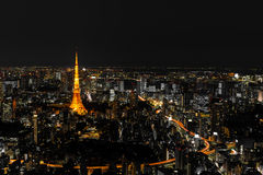 Illuminated Tokyo Tower and skyline at night from Roppongi Hills Royalty Free Stock Photos
