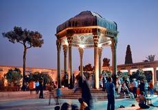 Illuminated Tomb of Hafez the Iranian Poet in Shiraz at Sunset. SHIRAZ, IRAN - SEPTEMBER 16, 2014: Illuminated Hafezieh monument, which is tomb of Hafez the Royalty Free Stock Photo