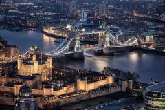 The illuminated Tower and the Tower Bridge of London by night stock photos