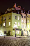 Illuminated townhouses at the square castle Stock Photography