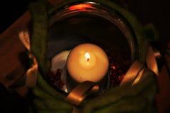 Illuminated traditional Christmas candle Royalty Free Stock Images