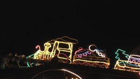 Illuminated train with Christmas gifts stock video footage