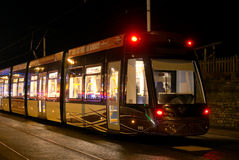 Illuminated trams Stock Images