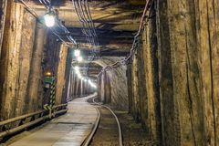 Illuminated underground tunnel in old mine Royalty Free Stock Images