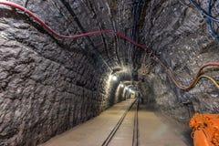 Illuminated underground tunnel in old mine Royalty Free Stock Image