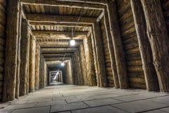 Illuminated underground tunnel in a mine Stock Image