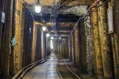 Illuminated underground tunnel in old mine Stock Photography