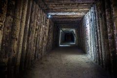 Illuminated underground tunnel in old mine Stock Image