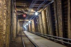 Illuminated underground tunnel in old mine Stock Photo