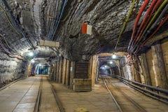 Two illuminated underground tunnels in old mine Stock Photo