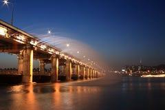 Illuminated urban bridge at night