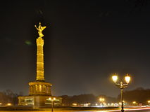 Illuminated Victory Column Siegesseule at night with shining street lamps in Berlin Stock Image