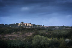 Illuminated Village in Tuscany after sunset Royalty Free Stock Image