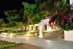 Illuminated villas at luxury hotel Stock Image