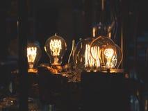 Illuminated Vintage Light Bulbs, Dark Background. Illuminated retro light bulbs, dark background, shallow depth of field Royalty Free Stock Image