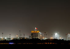 Illuminated VIP tower (Sakhir tower) on the occasion of National Day Fireworks at Bahrain Stock Photo