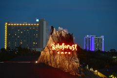 Illuminated Volcano with smoke outlet on Hotel buildings background at Lake Buena Vista. royalty free stock photo
