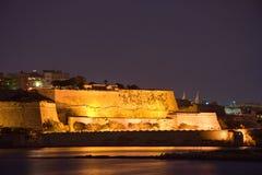 Illuminated Walls Of Valletta, Malta. A very tall part of the surrounding wall of Valletta, Malta Stock Images
