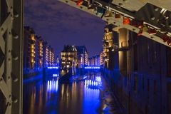 Illuminated water castle in Hamburgs old warehouse district stock photography