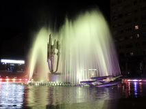 Illuminated water fountain at night Stock Image