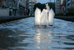 Illuminated water fountains in the evening Royalty Free Stock Images