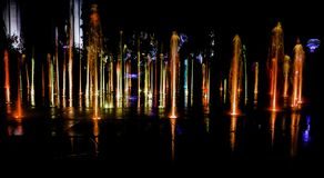 Illuminated water splash by night - Torun, Poland. Illuminated water splash by night in Torun, Poland royalty free stock image