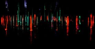 Illuminated water splash by night - Torun, Poland. Illuminated water splash by night in Torun, Poland stock photography