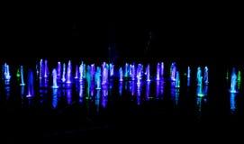 Illuminated water splash by night - Torun, Poland. Illuminated water splash by night in Torun, Poland royalty free stock photos