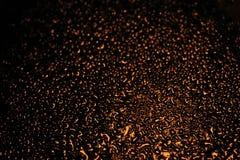 Illuminated water on window Royalty Free Stock Image