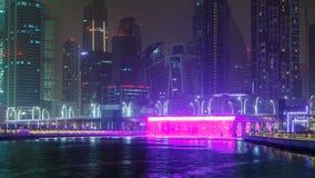 Illuminated Waterfall at the Sheikh Zayed Bridge timelapse, part of the Dubai Water Canal. Dubai, United Arab Emirates stock footage