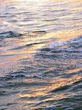 Illuminated waves, water surface Royalty Free Stock Images