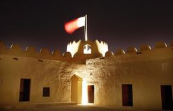Illuminated western tower of Riffa fort, Bahrain Stock Image