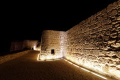 Illuminated western walls of Bahrain fort Stock Images