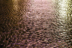 Illuminated wet pavement Stock Photo