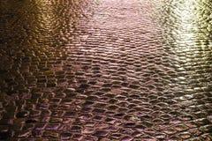 Illuminated wet pavement Stock Photo