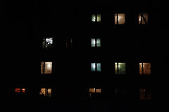 Illuminated windows of multistory building at night. Brightly illuminated windows of multistory building at night Stock Photography