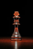 Illuminated wooden king chess piece Stock Photos
